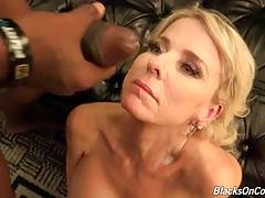 Nasty mature blonde enjoys the taste of black men cum.