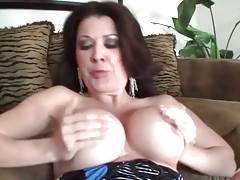 Raquel Devine lets younger guy enjoy the view of her big tits.