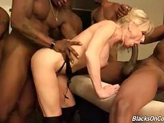 Mature blonde likes to feel big black dicks inside her eager love holes.