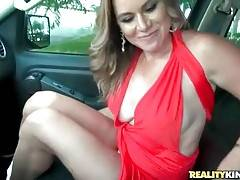 Milf lets guy enjoy the view of her rubbing her cunt in his car.